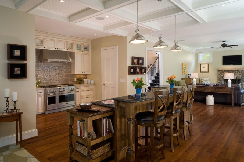 kitchen island with wooden bar table with black marble top, wooden stools with backs and black leather seating