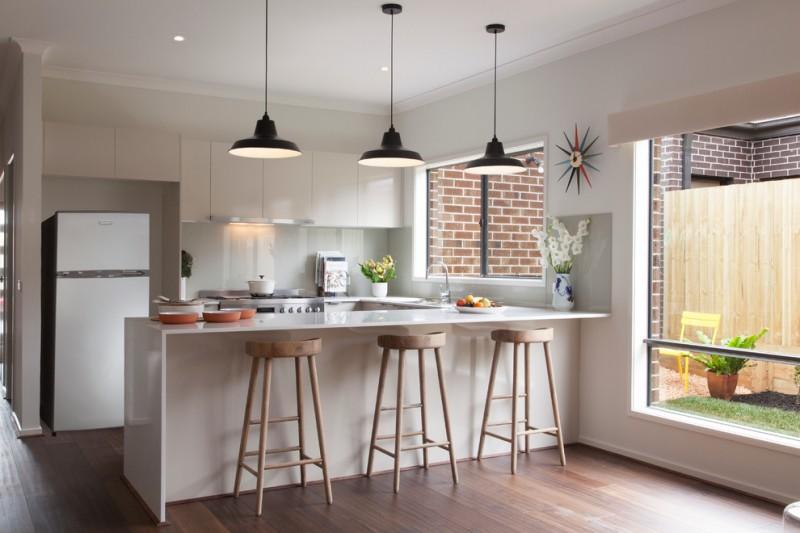 kitchen with white furniture, wooden floor, woden round sleek bar stool