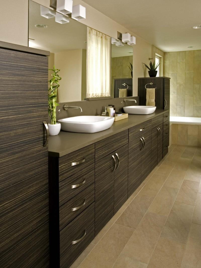 laminate vanity brown cabinet double vanity sink beige tiled wall porcelain floor built in tub bathroom lamps towel holder