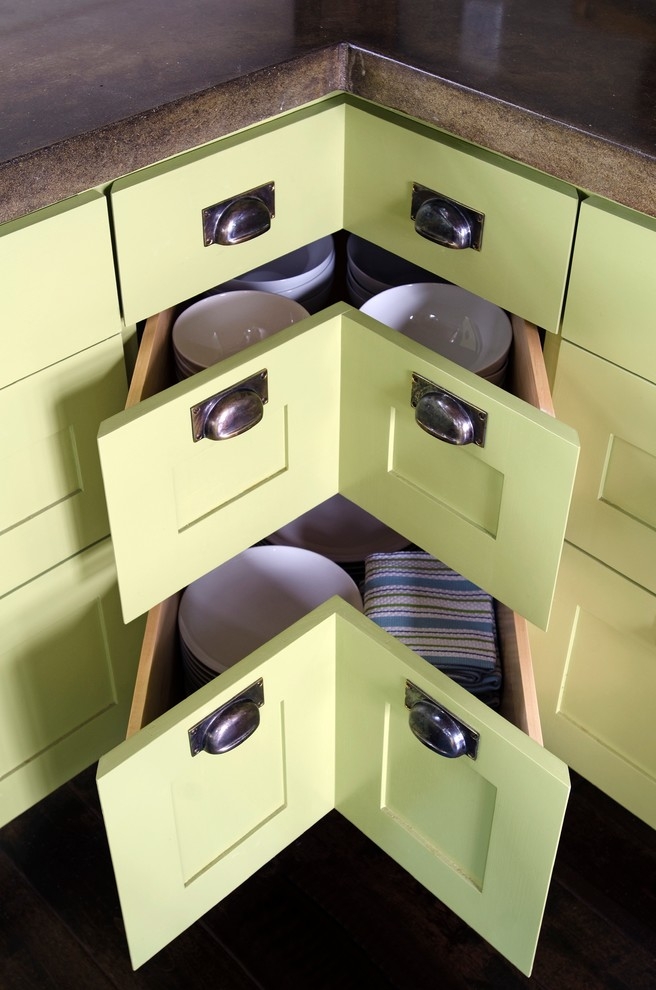 light green corner drawers and cabinets wit metal handles for contemperorary kitchen