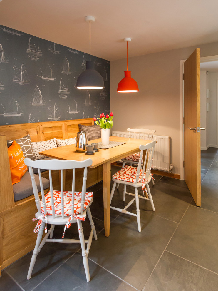 long banquette with wooden table, wooden corner bench with grey cuhion, white wooden chairs with orange cushion