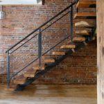metal stair stringers bricks brick wall pillar stairs wood floor railing industrial staircase
