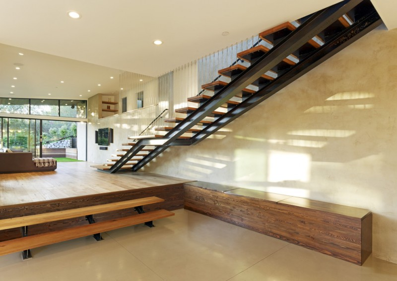 metal stair stringers ceiling lights seating shelves glass stairs wood parts modern staircase