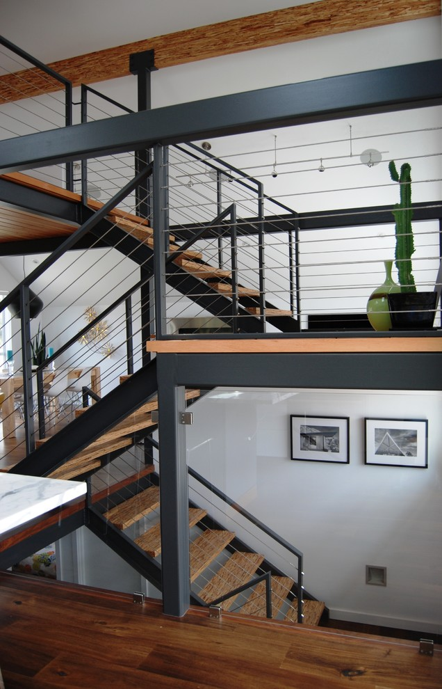 metal stair stringers railing plants wall decors wood floor stairs staircase contemporary style