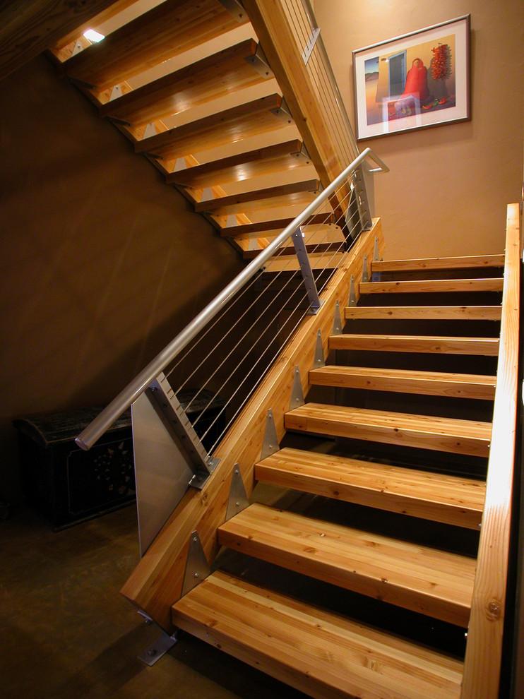 metal stair stringers staircase railings artwork hardwood floors lights industrial design