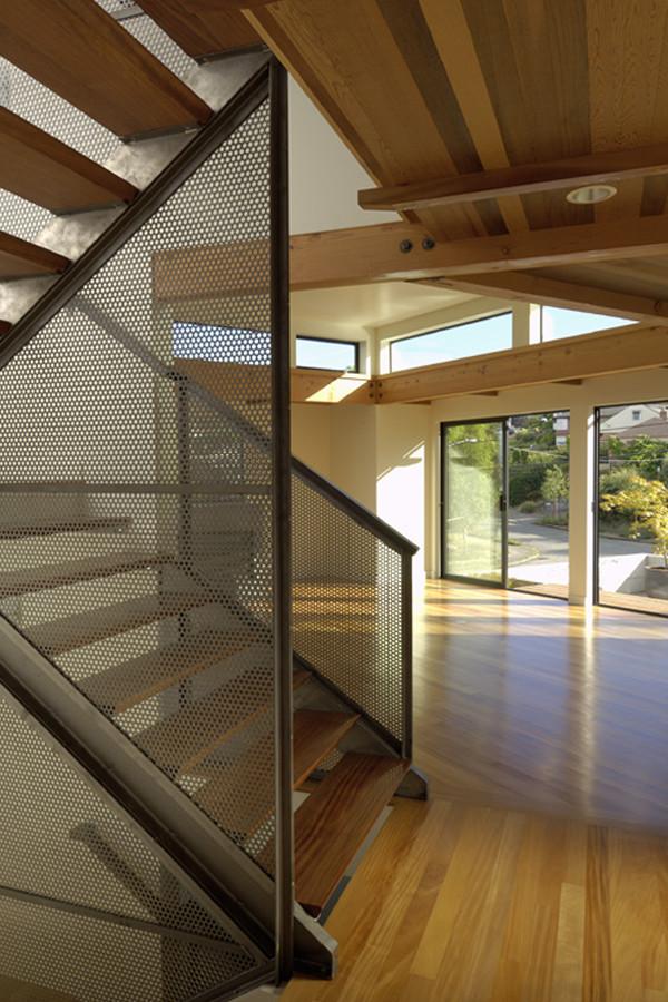 metal stair stringers wood treads hardwood floors window walls ceiling light modern design
