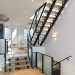 Metal Stair Stringers Wood Treads Sconce Chairs Double Glass Doors Hardwood Floors Ceiling Lights Rugs Scandinavian Design