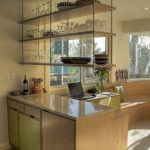 Midcentury Kitchen Idea With Stylish Hanging Kitchen Shelves Glossy White Countertop Colorful Cabinets Light Beige Walls
