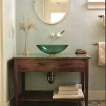 Modern Bathroom Vanity With Green Glass Sink And Round Shaped Decorative Mirror A Couple Of Vanity Light Fixtures