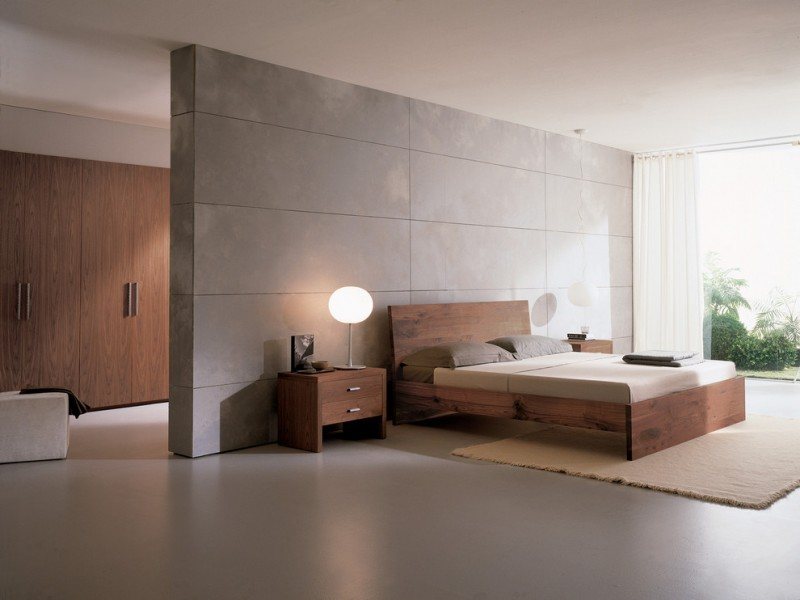 modern bed frame with headboard a pair of wood bedside tables with modern table lamps light beige bedroom rug grey solid floors grey solid walls
