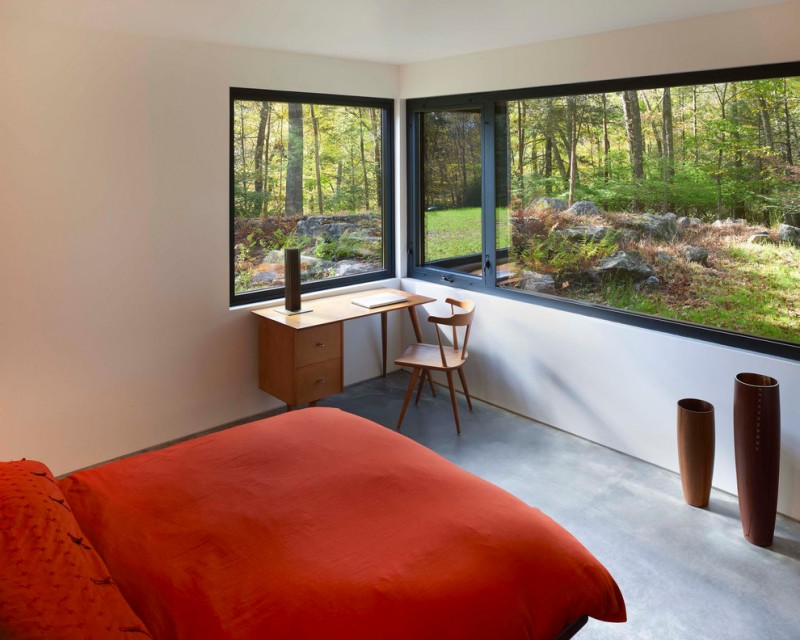 modern bedroom idea red bedding idea decorative vase in different size simple but modern study nook with soft textured wood chair and table black framed glass panels as the walls