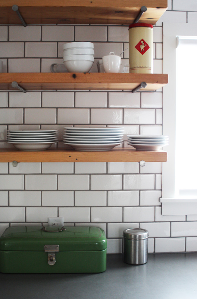 modern industrial kitchen idea with pine made kitchen shelves supported by giant nails white subway tiles