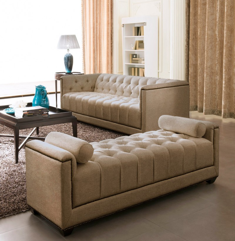 modern living room design upholstered sofa in cream upholstered settee with bolsters in cream dark grey area rug black painted coffee table