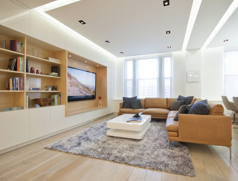 modern living room ideas cove lighting drop ceiling leather couch recessed lighting wall mount tv white coffee table wood flooring
