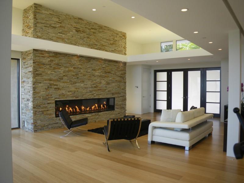 modern living room ideas stone fireplace surround montigo fireplace barcelona chair white modern sofa black table black rug windows
