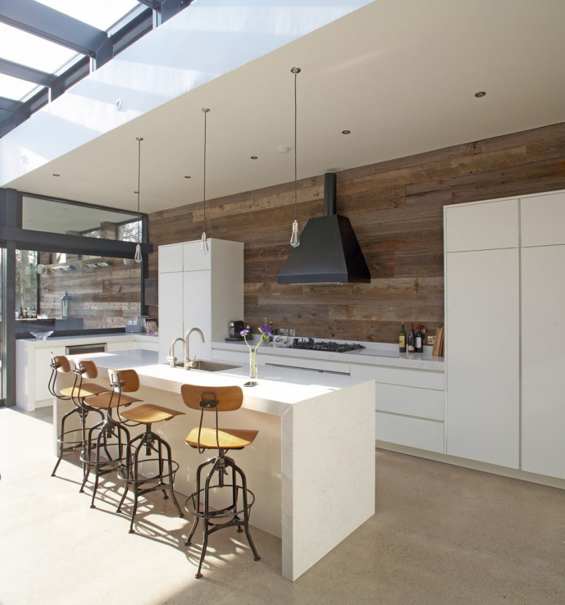 modern minimalist outdoor kitchen idea clean white kitchen counter clean white kitchen island flat panel cabinets in white industrial bar chairs dark hardwood walls without finishing