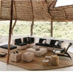 Modern Patio Furniture Set In Black And Light Tone A Set Of Wood Furniture Medium Toned Wood Floors Original Tree Trunk Pillars Decorative Vase