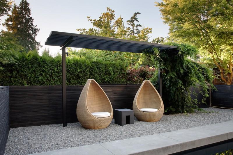 modern patio idea modern pergola in black finishing gravel floors reading chairs black finished wood railing system
