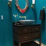 Modern Style Powder Room Blue Walls Dark Brown Vanity With Under Cabinets Free Standing Sink In White Mirror With Decorative Frame A Couple Of Wall Lamps