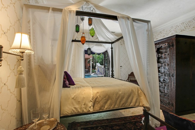 moroccan inspired bedroom white bed curtain moroccan chandeliers and wardrobe black patterned rug blue pillow beautiful wallpaper