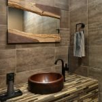 Mozaic Tiles On Vanity With Bronze Like Sink And Black Faucet, Artificially Cut Wood Framed Mirror, Brown Tiles For Wall