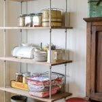 Narrow Industrial Shelves Made Of Pipes And Wood Boards