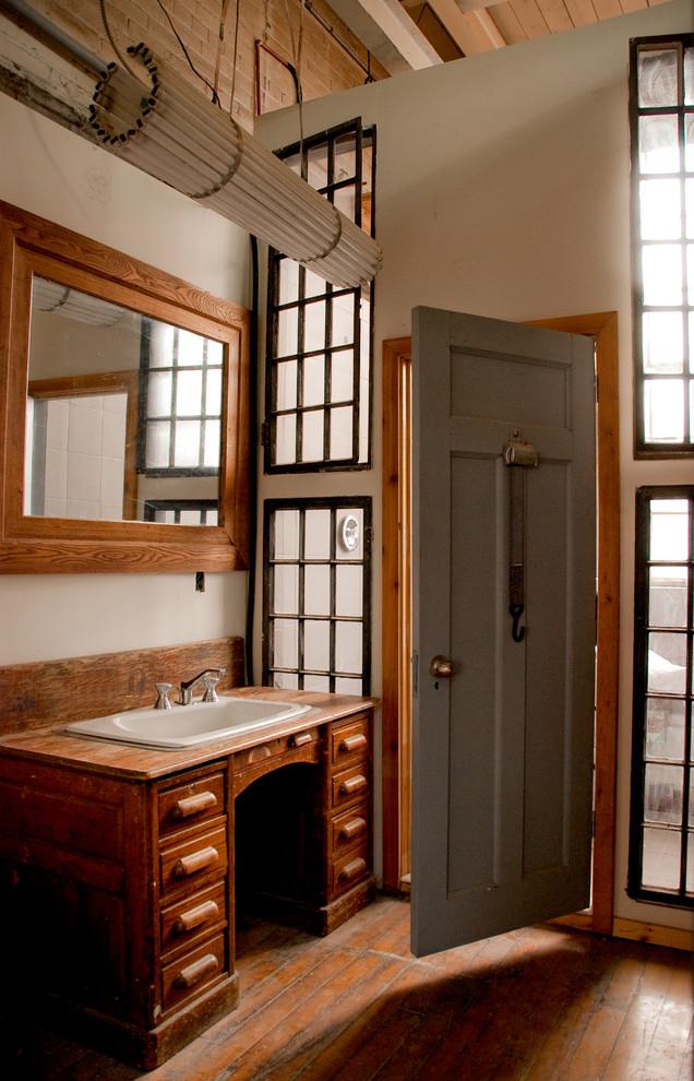 oak desk for vanity with varnished oak counter top, white sink