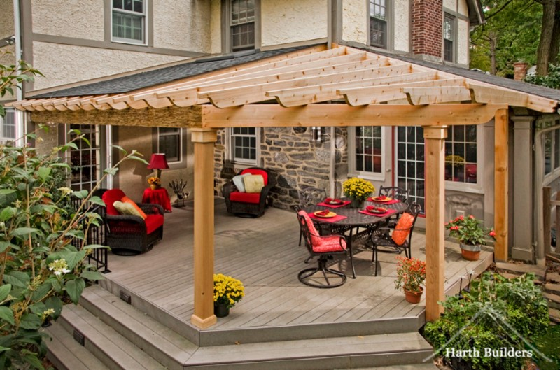 porch roof designs beam outdoor open roof trellis graduated raised angles wicker armchair sie table dining table set flowers