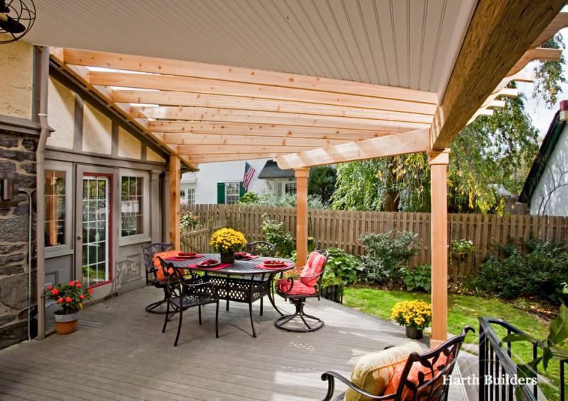 porch roof designs cedar covered patio exterior skylight outdoor dining trellis vinyl beadboard ceiling iron furniture