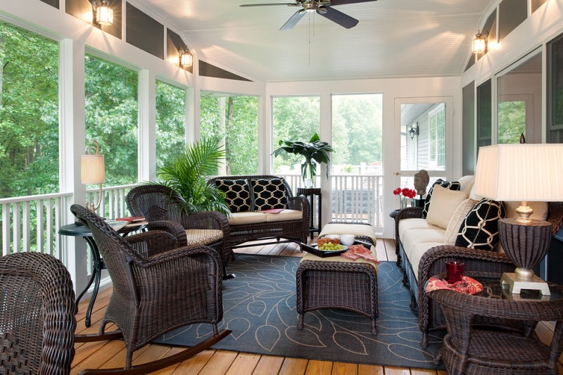 porch roof designs dark wicker outdoor ottoman chairs sofa and side table with glass table lamp dark leaves rug ceiling fan lamp