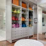 Purse Storage Ideas Color Coordinated Closet Colorful Purses Floor Mirror Glass Shelves Gray Cabinets Drawers And Ottoman Orange Boxes