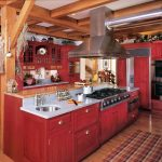 Red Painted Cabinets And Doors Wooden Pillars Kitchen Island With Granite Countertop Accent Rug Floating Cabinets Light Toned Wooden Floors
