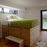 Rising Bed Frame With Under Storage Wood Bench Dark Toned Hardwood Dresser Medium Toned Wood Floors Wool Rug In White