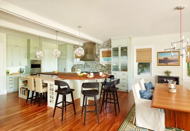 round kitchen island for bar seating with wooden top and wooden stools