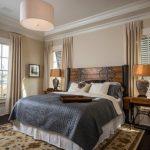 Rustic Industrial Bedroom Furniture Set Area Rug With Floral Motifs Cream Window Curtains Dark Hardwood Floors