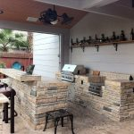 Rustic Outdoor Kitchen Design Bricks Kitchen Counter With Solid Countertop Black Stained Hard Metak Furniture Industrial Shelf Mounted On Walls Stainless Steel Appliances