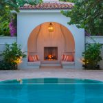 Secluded Small Cabana In A Nook With Fireplace, Built In Couch, Pendant Lamp