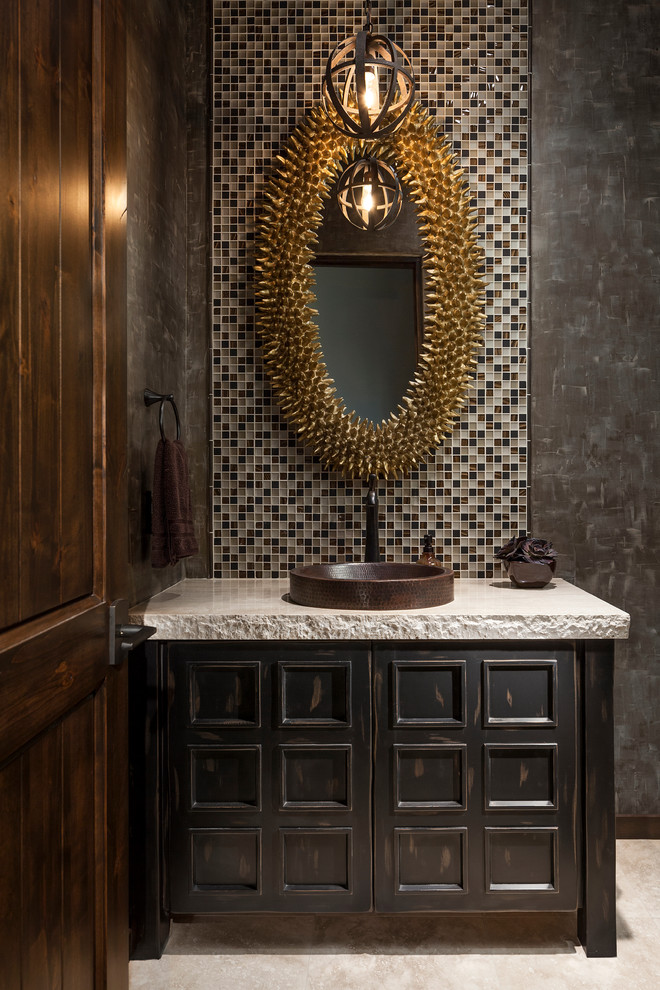 simpel wooden two door cabinet with white stone counter top, bronze sink, unique round mirror with spikey frame