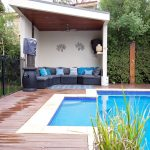 Simple Modern Pool Cabana With Wooden Ceiling, Ceiling Fan, Grey Sofa, Blue Rug
