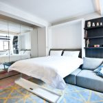 Small Master Bedroom Ideas Built In Foldable Bed Couch Built In Shelves Mirrored Closet Colorful Rug Patterned Pillow Recessed Lighting