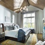 Small Master Bedroom Ideas Chandelier Vaulted Ceiling Windows Drapery With Curtain Rod Mediterranean Rug Bed With Tufted Headboard Nightstands