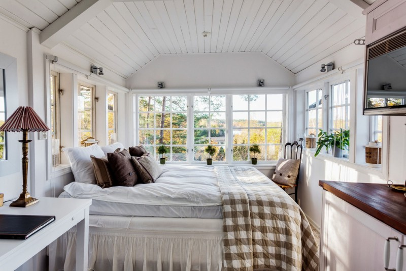small master bedroom ideas lots of windows small industrial pendants country style bed pillows wood table storage table lamp small plants