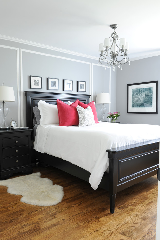 small master bedroom ideas wooden bed and headboard fuscha pop pillows side tables chandelier small white rug wood flooring grey wall