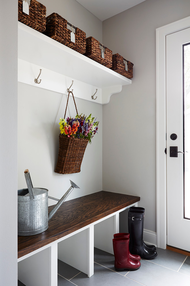 small mudroom ideas large watering can handled wicker basket hanging basket flowers backet oak built in bench