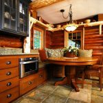 small rustic cabins glass front cabinets windows cool lamp round top table chair bench pillows telephone beautiful room