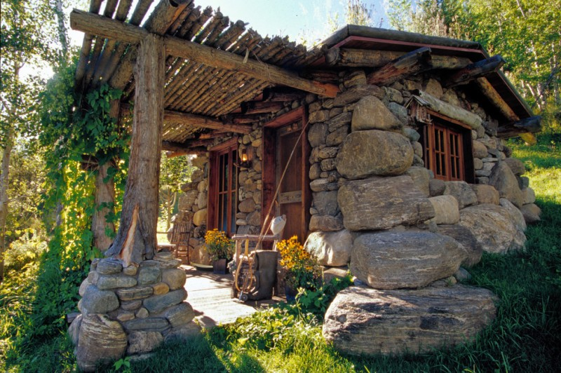 small rustic cabins pillars rocks window door flowers chairs logs beautiful exterior