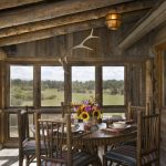 small rustic cabins table chairs flowers windows cool lamp logs wood floor beautiful porch