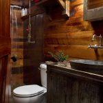 small rustic cabins toilet towels shower vanity wooden wall cool lamp shelf beautiful bathroom