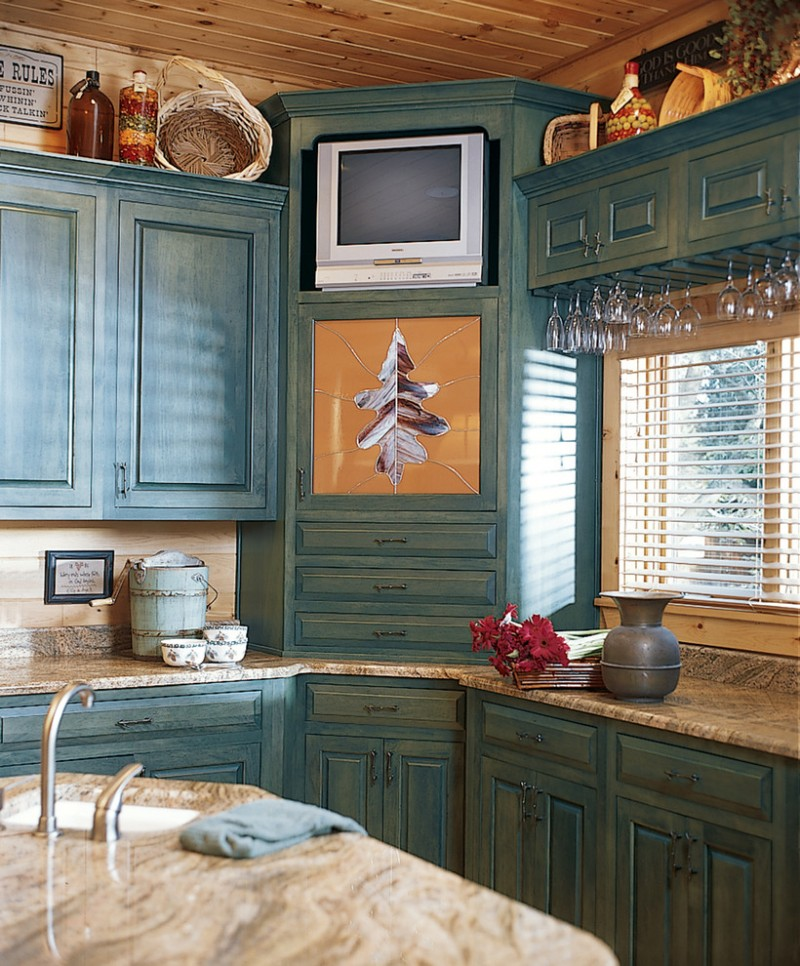 traditional kitchen with old greyish blue corner cabinet