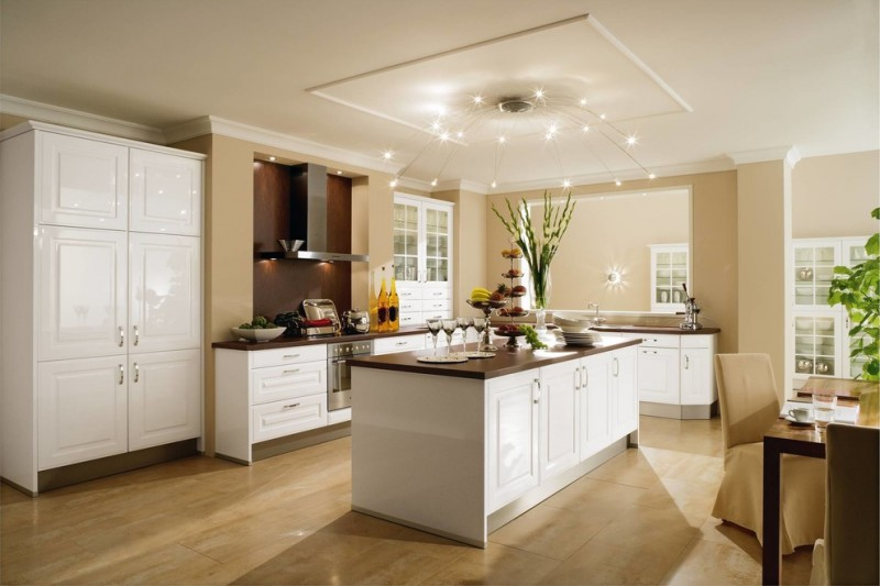 transitional kitchen design with white corner cabinet L shaped countertop white under cabinets solid surface kitchen island with white base and storage addition beige porcelain floors beige walls